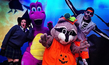 Performers on stage in halloween costumes