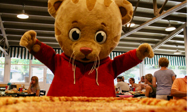 Daniel Tiger standing with Pizza