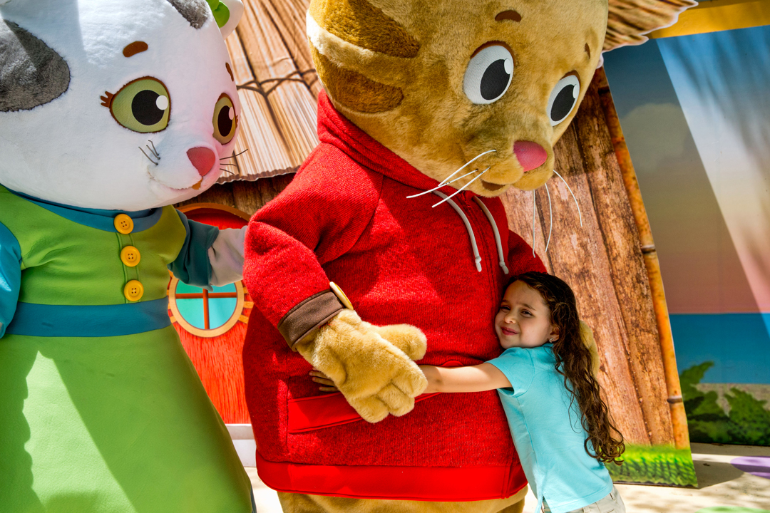 Little girl hugging Daniel Tiger
