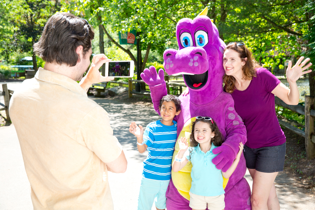 Family posing with Duke the Dragon, dad taking photo