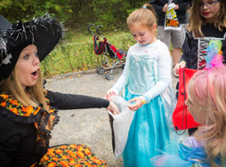 Kids treat or treat at Goldilocks House in Story Book Forest