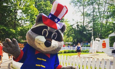 Park Mascot Ricky Raccoon dressed in a patriotic tophat and coat