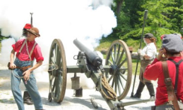Civil War reenactors fire a cannon