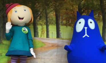 Peg + Cat characters from the PBS show on stage at Idlewild
