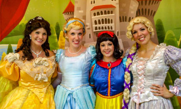 4 Princesses stand on the Hillside Theater Stage at Idlewild