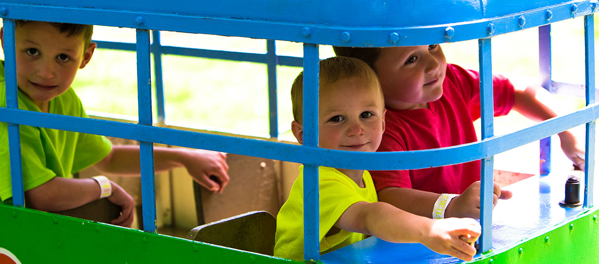 Children playing in small trolley car