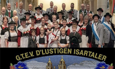 Isartaler bavarian Dance group posed by banner with name
