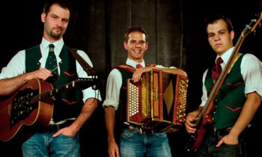 Madel Jager band posing with instruments