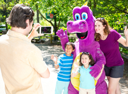 Family taking photo with Duke the Dragon